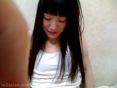 chinese woman playing with her pussy at home
