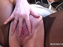 Babe in stockings messes her sexy pussy with vibrator