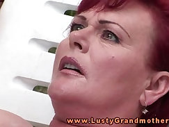 Busty mature granny finger fucks and fills her mouth