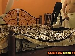 Amateur black babe plays with a white cock